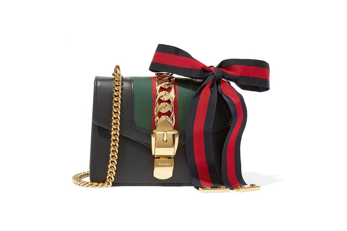 Sylvie mini canvas-paneled leather shoulder bag