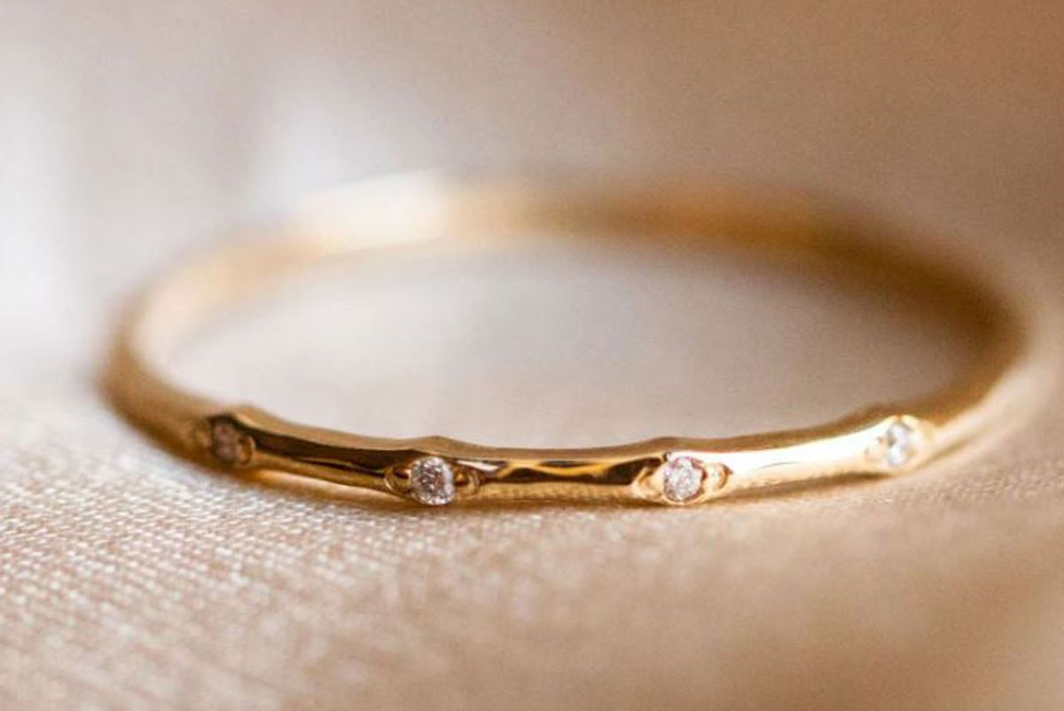 local eclectic solid gold textured diamond band