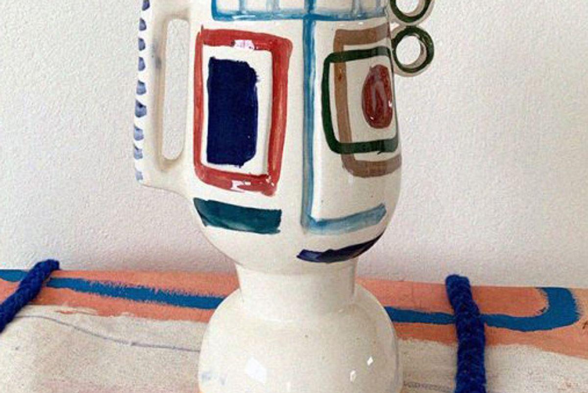 lrnce carved visage vase 10