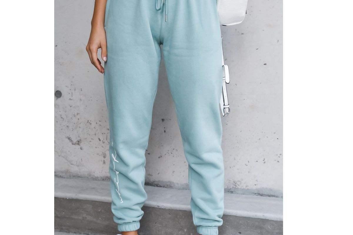 white fox tied together sweatpants