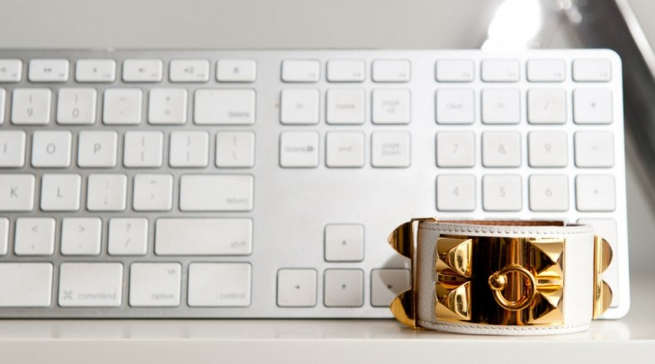 One of my favorite cuffs in white leather alongside another chic accessory, an Apple keyboard! We are obviously unanimous M.A.C. people at the Rachel Zoe headquarters.
