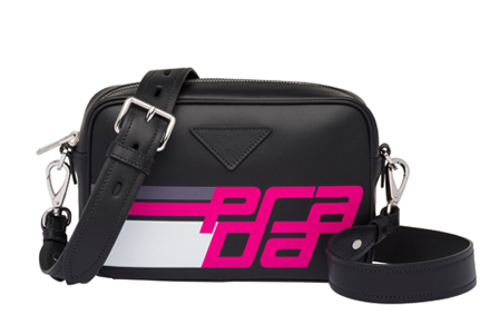 38fb4b4484e4e3 Not your basic black bag. The hot pink racer-style lettering gives a whole  new feel to this otherwise classic shape.